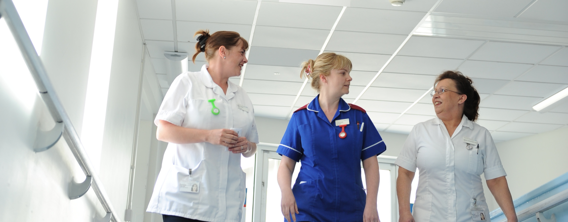 Three members of the clinical team walking down a corridor